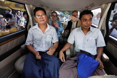 Reuters reporters Wa Lone and Kyaw Soe Oo react in a vehicle after being freed from Insein prison after receiving a presidential pardon in Yangon, Myanmar, May 7, 2019.