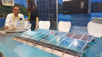 A business in Ho Chi Minh City promotes solar panels, one of the sources of renewable energy being considered by Vietnam.