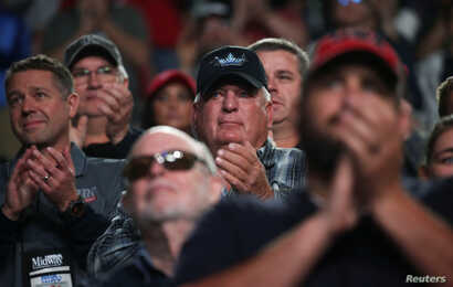 Members applaud as U.S. President Donald Trump addresses the National Rifle Association (NRA) 148th annual meeting in Indianapolis, Indiana, U.S., April 26, 2019.