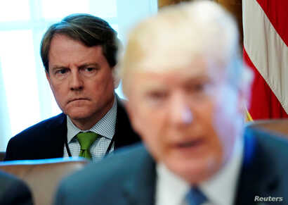 White House Counsel Don McGahn sits behind U.S. President Donald Trump as the president holds a cabinet meeting at the White House in Washington, U.S. June 21, 2018.