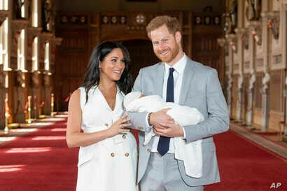 Britain's Prince Harry and Meghan, Duchess of Sussex, during a photocall with their newborn son, in St George's Hall at Windsor Castle, Windsor, south England, May 8, 2019.