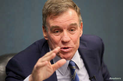 Sen. Mark Warner (D-VA) talks with military families about their hazardous living conditions during a meeting at the Peninsula Workforce Development Office in Newport News, Virginia, March 11, 2019.