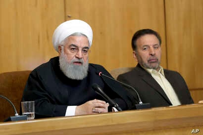 In this photo released by the official website of the office of the Iranian Presidency, President Hassan Rouhani speaks during a cabinet meeting in Tehran, Iran, Wednesday, April 24, 2019.