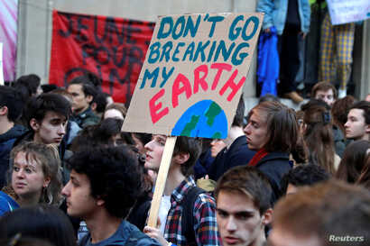 "Youths demonstrate for climate change during the ""Fridays for Future"" school strike, in front of the Ecology Ministry in Paris, France, Feb. 15, 2019."