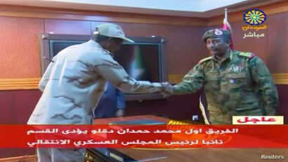 Sudan's General Mohamed Hamdan Dagalo, known as Hemedti, head of the Rapid Support Forces, is sworn-in as the appointed deputy of Sudan's Transitional Military Council, standing before the head of transitional council, Lieutenant General Abdel Fattah...