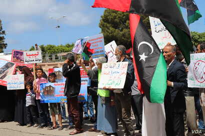 Protesters objecting to foreign contributions to the assault on Tripoli gather outside the Ministry of Foreign Affairs in Tripoli, Libya, April 28, 2019.