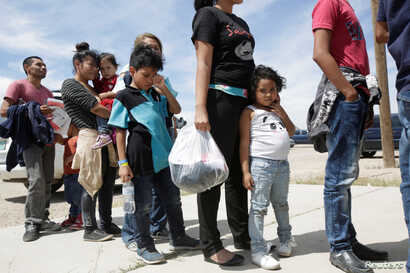 Central American migrants stand in line before entering a temporary shelter, after illegally crossing the border between Mexico and the U.S., in Deming, New Mexico, May 16, 2019.