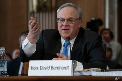 David Bernhardt, a former oil and gas lobbyist, speaks before the Senate Energy and Natural Resources Committee at his confirmation hearing to head the Interior Department, on Capitol Hill in Washington, March 28, 2019.