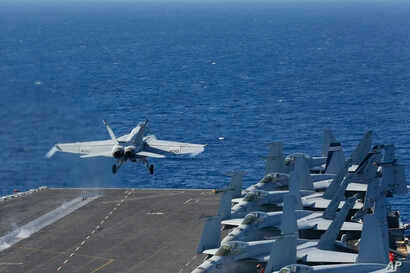 FILE - An F/A-18E Super Hornet from VFA 25 launches from the flight deck of the Nimitz-class aircraft carrier USS Abraham Lincoln, May 3, 2019.