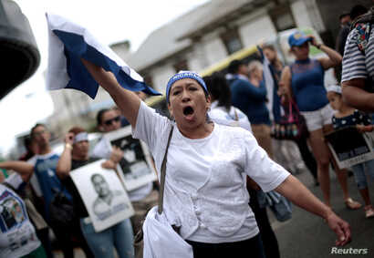 A Nicaraguan living in Costa Rica takes part in a protest in front of the Nicaraguan Embassy in San Jose, Costa Rica, Feb. 27, 2019,  against the talks Nicaraguan President Daniel Ortega will resume with the leaders of the opposition.