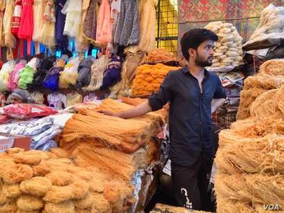 Vendor hawk traditional food items at a market in a Muslim dominated neighborhood in Delhi.