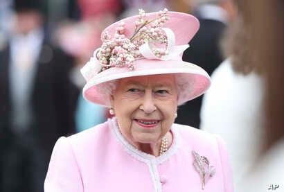 FILE - Her Majesty Queen Elizabeth II during a garden party at Buckingham Palace in London, England, UK.
