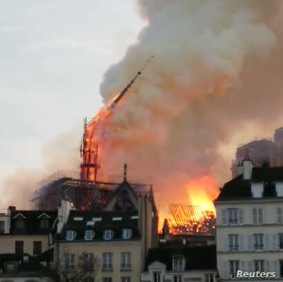 The Notre Dame Cathedral spire collapses during a fire in Paris, France April 15, 2019 in this image taken from social media video. (Instagram/@nicolas_marang)