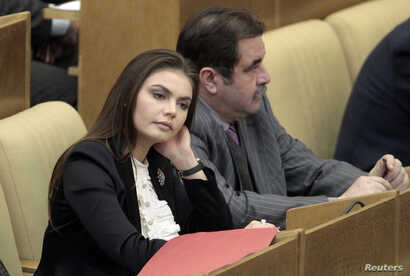 FILE - Former Olympic gymnast Alina Kabaeva, at the time deputy chair of the State Duma Committee for Youth Affairs is seen during a session of the State Duma, Russia's lower house of parliament, in Moscow, April 20, 2011.
