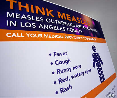 A poster released by Los Angeles County Department of Public Health is seen as experts answer questions regarding the measles response and the quarantine orders in Los Angeles, April 26, 2019