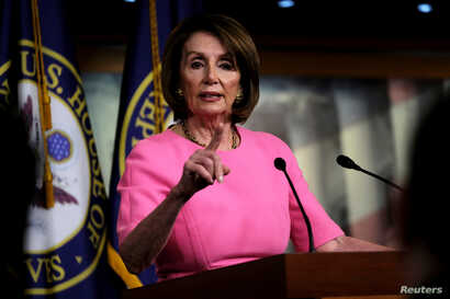 FILE - U.S. House Speaker Nancy Pelosi (D-CA) holds her weekly news conference with Capitol Hill reporters in Washington, May 23, 2019.