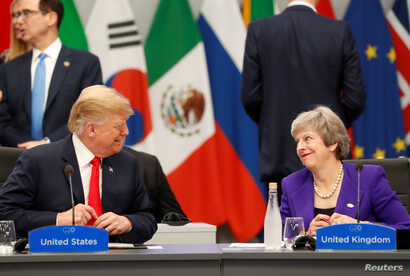 U.S. President Donald Trump and Britain's Prime Minister Theresa May attend the G20 leaders summit in Buenos Aires, Argentina, Nov. 30, 2018.