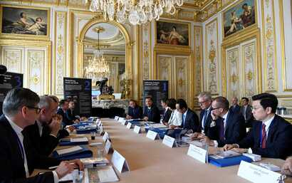 """Delegates gather during a """"Tech For Good"""" summit in Paris, May 15, 2019. Several world leaders and tech bosses are meeting in Paris to find ways to stop acts of violent extremism from being shown online."""