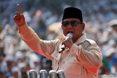 FILE - Indonesia's presidential candidate Prabowo Subianto speaks during a campaign rally with his running mate Sandiaga Uno at Gelora Bung Karno Main Stadium in Jakarta, Indonesia, April 7, 2019.