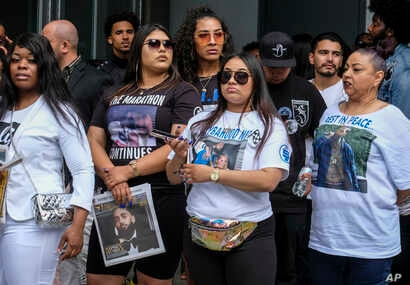 Fans of rapper Nipsey Hussle wait in line to attend his public memorial service at Staples Center in Los Angeles, April 11, 2019. Hussle was killed in a shooting outside his Marathon Clothing store in south Los Angeles, March 31.
