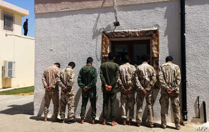 Fighters loyal to military commander Khalifa Haftar, reportedly minors, are imprisoned by forces from the U.N.-backed Government of National Accord (GNA) in Tripoli's suburb of Ain Zara, April 11, 2019.