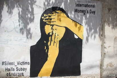 "This mural titled ""Silent Victims"" by Yemeni artist Haifa Subay shows a woman unable to see or speak. The U.N. Population Fund warns that women in Yemen are paying the heaviest price in the conflict."