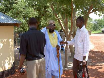 Dong Samuel Luak, at right, greeting South Sudan President Salva Kiir. (Photo: Dong's Facebook page)