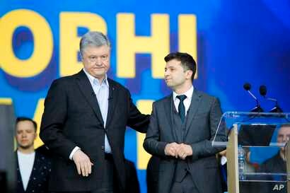 Ukrainian President Petro Poroshenko, left, and Ukrainian presidential candidate and popular comedian Volodymyr Zelenskiy attend debates at the Olympic stadium in Kiev, Ukraine, April 19, 2019.