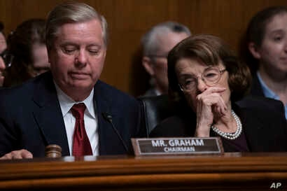 Senate Judiciary Committee Chairman Lindsey Graham, R-S.C., left, and Sen. Dianne Feinstein, D-Calif., the ranking member, prepare to take a break during questioning of Attorney General William Barr about special counsel Robert Mueller's Russia repor...