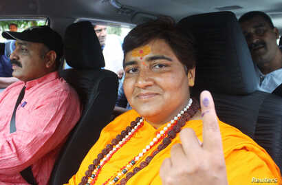 Pragya Singh Thakur, leader of ruling Bharatiya Janata Party (BJP), shows her ink-marked finger after casting her vote, outside a polling station in Bhopal, India, May 12, 2019.