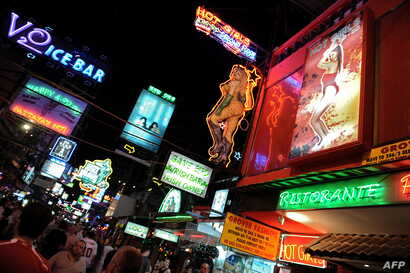 FILE - People walk in the red light district in Pattaya, Thailand, April 10, 2009. At the time, the U.S. put Thailand on its human trafficking watch list, accusing it of not doing enough to combat trafficking.