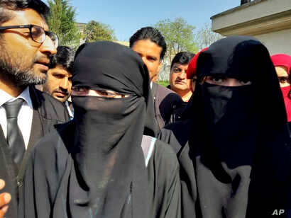 Pakistani girls from the Hindu community wearing black veils, arrive at a court in Islamabad, Pakistan, March 26, 2019.