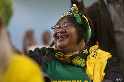 A supporters of the ruling African National Congress (ANC) attends a campaign meeting with the South African president and president of the ANC, in Mitchells Plain, Cape Town, South Africa May 3, 2019, ahead of general elections.