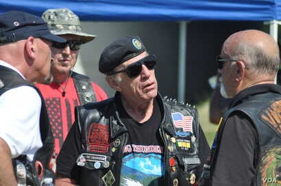 Rolling Thunder executive director is seen with fellow motorcyclists at the Pentagon, in Arlington, Virginia, outside of Washington, May 26, 2019.