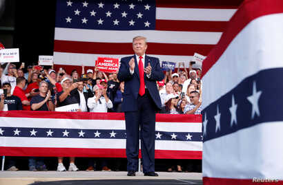 U.S. President Donald Trump on stage during a campaign rally in Panama City Beach, Fla., May 8, 2019.