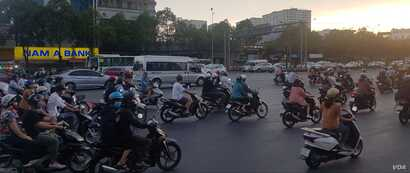 Even on a weekend, the streets of Ho Chi Minh City are filled with motorbikes, which sometimes carry a family of five at once.