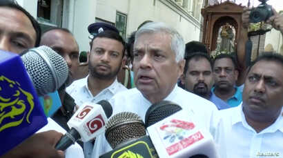 Sri Lanka's Prime Minister Ranil Wickremesinghe speaks to media at St. Anthony's Shrine in Colombo, Sri Lanka, April 21, 2019 in this image obtained from a video.