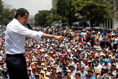 Veceuela, Caracas, Venezuelan opposition leader Juan Guaido speaks during a rally