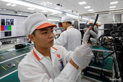 A manufacturer works at an assembly line of Vingroup's Vsmart phone in Hai Phong, Vietnam, Dec. 4, 2018.