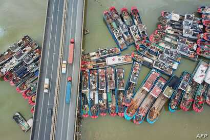 This aerial image shows fishing boats docked on the last day of the summer fishing moratorium, as they prepare to leave port in Lianyungang in eastern China's Jiangsu province.