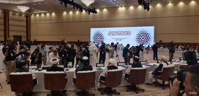 Media was only allowed to briefly take pictures at the start of the intra-Afghan dialogue and was asked to leave before the opening statements, in Doha, Qatar, July 7, 2019. (A. Tanzeem/VOA)