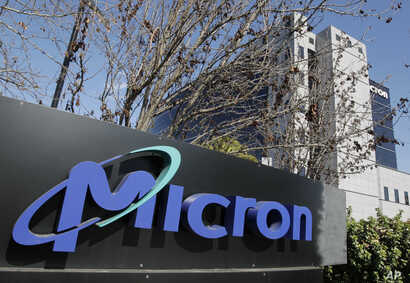 This Feb. 3, 2012 file photo shows the exterior view of memory chip maker Micron offices in San Jose, Calif.