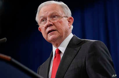 Attorney General Jeff Sessions speaks during a news conference to announce a criminal law enforcement action involving China, at the Department of Justice in Washington, Nov. 1, 2018.