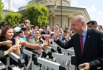 Turkey's President Recep Tayyip Erdogan speaks to his supporters after Friday prayers, in Ankara, Turkey, Aug. 23, 2019. Erdogan discussed the situation in Syria with Russia's President Vladimir Putin.