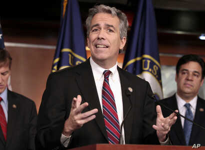 In this Nov. 15, 2011, file photo former U.S. Rep. Joe Walsh, R-Ill., gestures during a news conference on Capitol Hill in Washington.