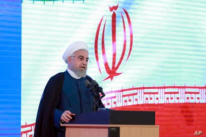 In this photo released by the official website of the office of the Iranian Presidency, President Hassan Rouhani speaks in a ceremony in Tehran, Iran, Tuesday, Aug. 27, 2019.