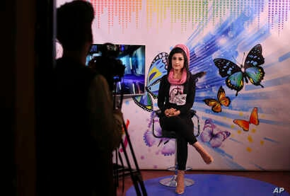 Karishma Naz, music presenter on Zan TV records a show, in Kabul, Afghanistan, Aug. 22, 2019.