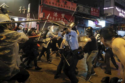 Policemen clash with demonstrators on a street during a protest in Hong Kong, Aug. 25, 2019.