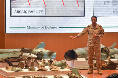 Saudi Colonel Turki al-Malki displays pieces of what he said were Iranian cruise missiles and drones recovered from the attack site that targeted Saudi Aramco's facilities, during a press conference in Riyadh, Sept. 18, 2019.