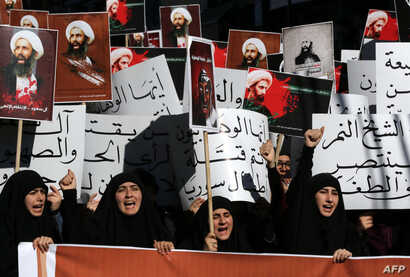 Lebanese protesters take part in a demonstration against the execution of prominent Shi'ite Muslim cleric Nimr al-Nimr (pictured on the posters) by Saudi authorities, in the southern Lebanese city of Nabatiyeh, Jan. 13, 2016.